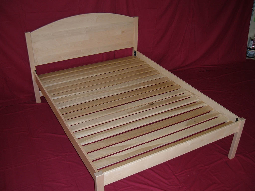 Solid Maple Natural Finish Bed With Spaced Slats And Arched Headboard . Full resolution‎  image, nominally Width 1024 Height 768 pixels, image with #440D17.