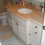 Custom Hardwood Vanity With Bead Board Doors Distressed