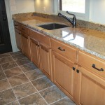 Maple and Granite Utility Room Sink and Cabinets