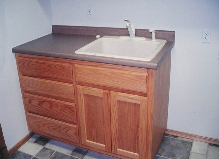 Utility Room Sink And Cabinets Red Oak